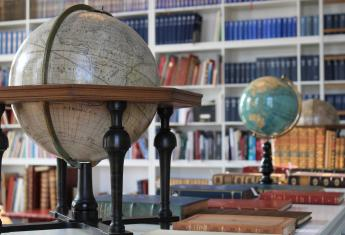 Globe in Library About ILAB